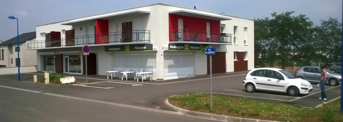 Construction d'un petit collectif de 4 logements et 3 cellules commerciales à Volstroff